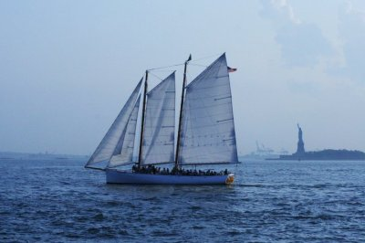 A sailboat, and the Statue of Liberty from Battery Park