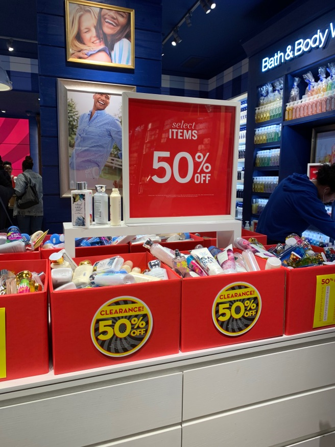 Red clearance bins marked 50% off at Bath and Body Works.